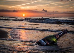 bottle of wine made in Celler Jordi Lluch winery swimming in sea