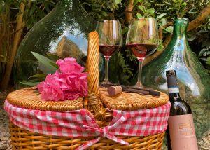 A Bottle Of Wine By Corte Fornaledo Winery Along A Bamboo Basket