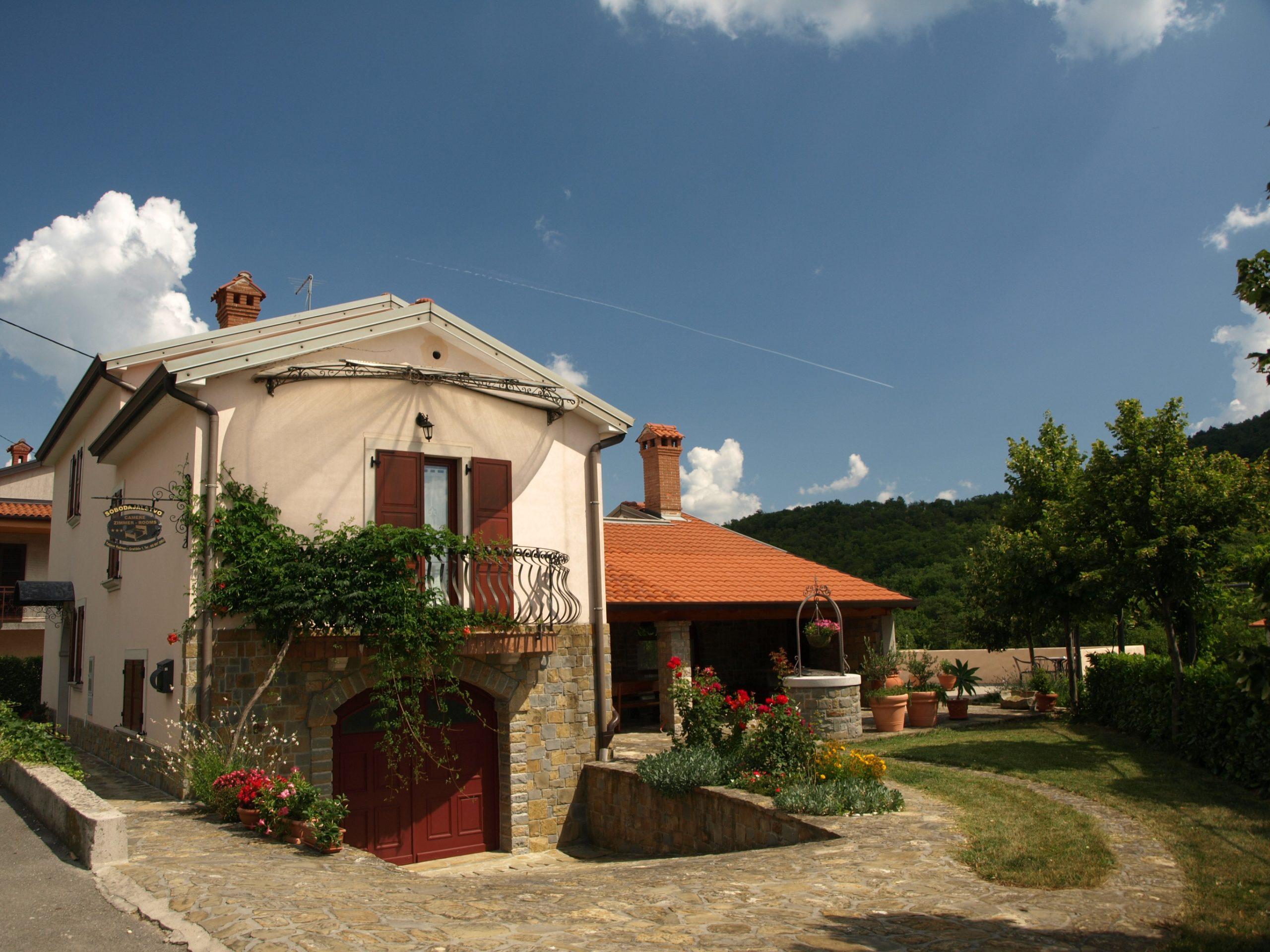 Front view of two storey winery building of Domačija Ražman.