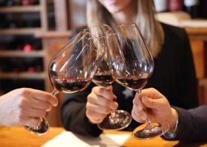 Three People Toasting Glass Of Wine At Le Bignele Winery