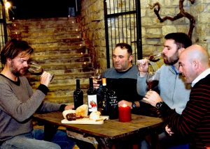 Four Men Tasting Wine At Le Masciare Winery