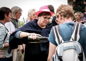 Owner Of Les Caves De La Loire Winery Pouring Wine
