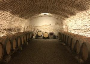 Wine barrels inside the cellar of Les Celliers de la Pauline winery