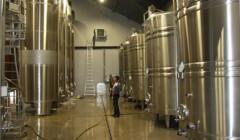 Large fermentation steel tanks inside the Les celliers de la Pauline Winery
