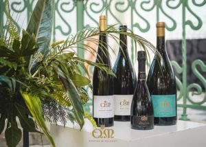 Wine botles displayed in the window pane of the Quintas de Melgaço winery