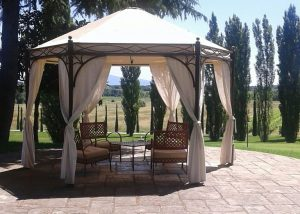 Pergolar With Tasbles And Chairs At San Ferdinando Winery