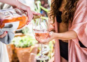 semeli estate woman tasting beautiful rose wine from the winery