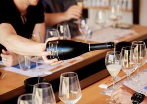a man pouring wine into a glass at tenuta gorghi tondi winery