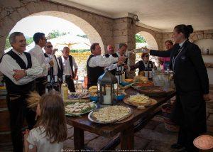 People Enjoying Tasting Session At Tenuta Muscazega Winery