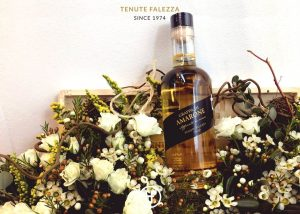 A Bottle Wine In A Wooden Box With Flowers At Tenute Falezza Winery