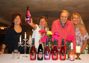 People Posing With The Bottles Of The Wines At Torti L'Eleganza Winery