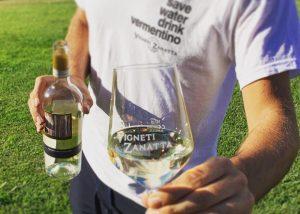 A Man Showing A Bottle Of Wine And Glass At Vigneti Zanatta Winery