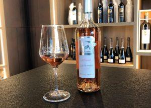 A Bottle Of Wine By Vigneti Zanatta Winery Along With A Glass Of Wine