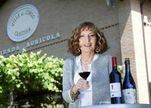 A Woman Tasting Wine At Villa Di Corlo Winery