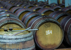 vinprom rousse many wooden barrels with wine in the cellar