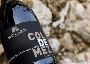 a close up shot of a bottle of wine by Cantina Colli Del Soligo