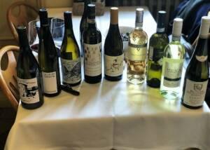 different bottle of wine by agriturismo castello della mugazzena on a table