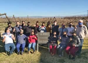 Team of De Krans Wines winery posing in the vineyard