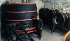 winemaker of fattoria montereggi standing beside a large barrel