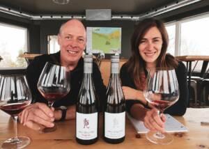 A Man And Woman Tasting Wine At Flat Rock Cellars Winery