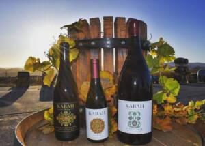 Three wine bottles of the Karah estate vineyard