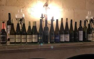 WIne Bottles of Natascha Quester on Display