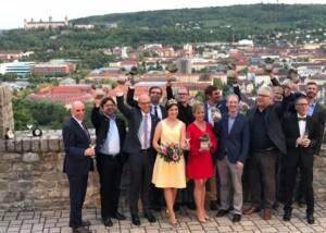 A Group Of People Cheerfully Posing At Weingut Uwe Geßner Winery