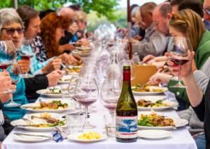 People enjoying wine and food at Ashton Hills Vineyards