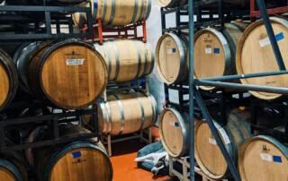 Oak barrels inside the cellar room at Avinodos winery