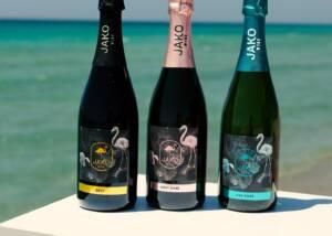 Three Wine Bottles of Jako Wine at The Beach