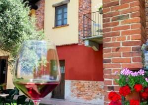 A Glass of Wine and Building of Centovigne - Castello Di Castellengo